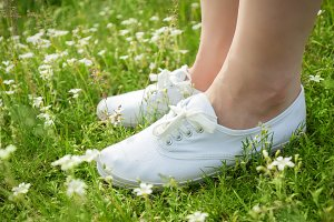 Woman in white classic sneakers.