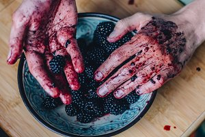 Man's hand holding a blackberry