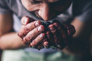 Man smelling blackberries