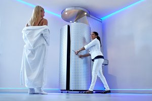 Woman taking cryosauna