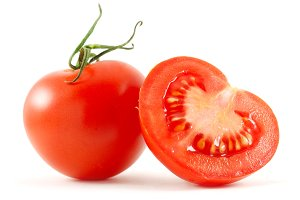 two tomatoes isolated on white