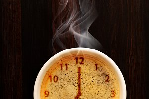 cup of fresh espresso with clock