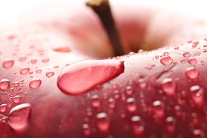 red wet apple with big droplet, macro shot