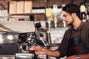 Male barista preparing espresso