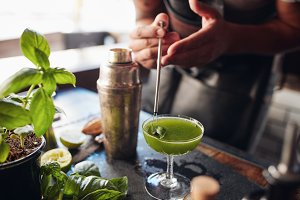 Bartender preparing fresh basil