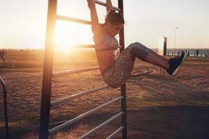 Woman performing hanging leg