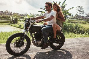 Young couple enjoying motorcycle