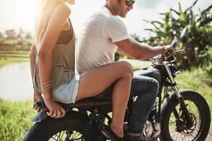 Young couple riding on a motorcycle