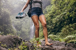 Woman hiking barefoot