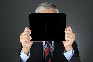 Businesman Behind Tablet Computer