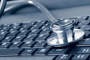 stethoscope on the laptop keyboard