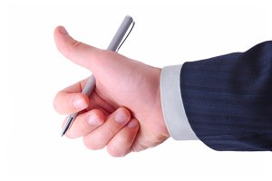 businessman shows thumb up and holds silver pen