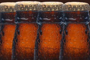 Four Wet Beer Bottles
