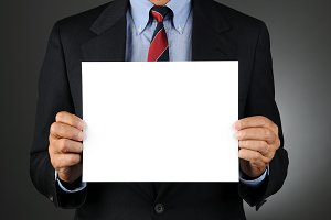 Businesman Holding Blank Sign