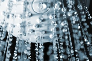 closeup view of water flowing out of shower in dark