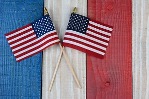 Two American Flags on Painted Wood