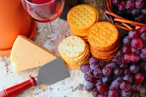 Wine, cheese and crackers still life