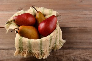 Bosc and Red Pears in Basket