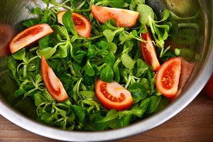 Healthy salad with fresh tomato salat rosemary and soy sauce