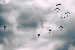 Parachutists in the clouds