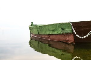 old wooden boat in fog