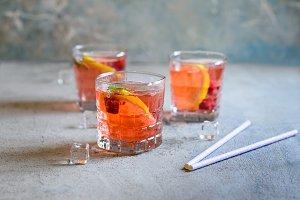 Raspberry lemonade with ice cubes