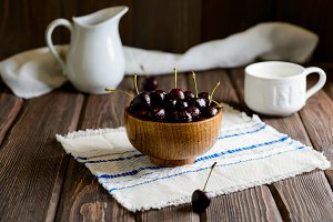 Sweet cherry in wood bowl