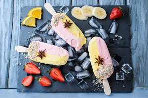 Banana and strawberry popsicles