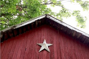 Rustic Red Barn with Star in Spring