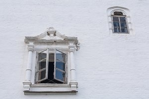 two windows on a white wall