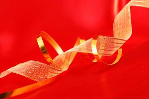 Red silk and golden ribbons background