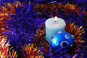 Christmas background with blue candle and ball