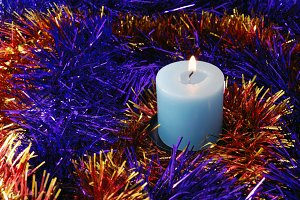 Christmas background with blue candle