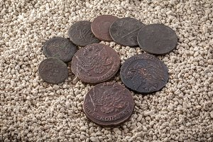 copper coins in a patina and oxides