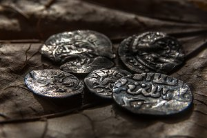 old coins in a twilight
