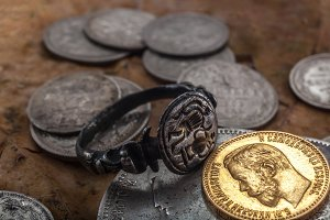 gold coin and gilded ring