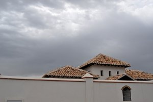 house and dramatic sky