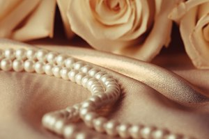 Pearl beads and cream rose
