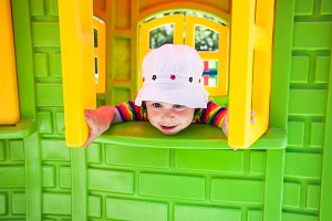 Adorable girl on a playground