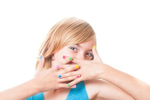 Girl with rainbow nails