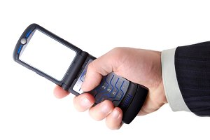 businessman holds mobile phone