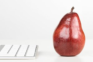 keyboard with red pear