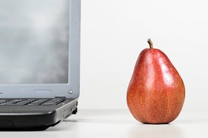 laptop with red pear