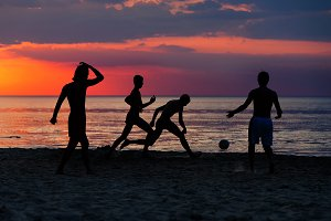 Silhouettes of footballers
