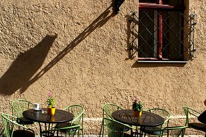 Outdoor cafe with shadows