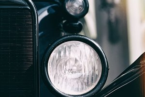 Headlights and grille of vintage car