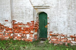 green door in an ancient wall