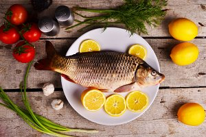 fresh fish Cyprinus carpio carpio with the vegetables  and lemon