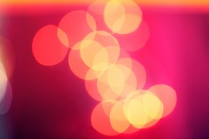 Yellow lights bokeh on pink