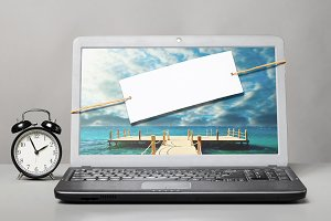 laptop with blank note